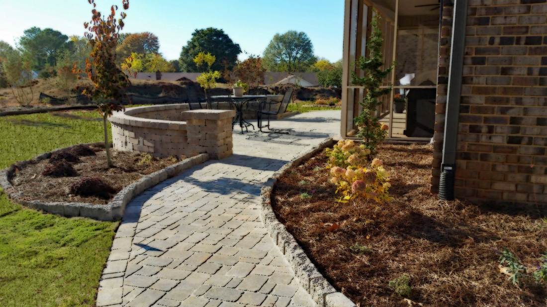 Landscape install project of dublin cobble pavers, weston stone sitting  wall and landscape beds. - View Photo Gallery Of Completed Landscape Design Projects By Green