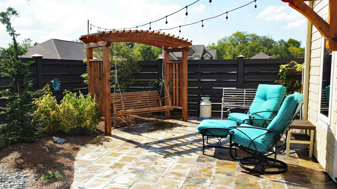 Charmant The Arbor Feature Was Repeated Over The Doors To The House. String Lights  From The House To The Fence Add Night Lighting. The Fence Design Is A  Horizontal, ...