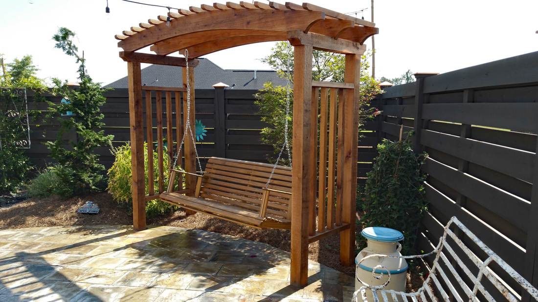 The Arbor Feature Was Repeated Over The Doors To The House. String Lights  From The House To The Fence Add Night Lighting. The Fence Design Is A  Horizontal, ...